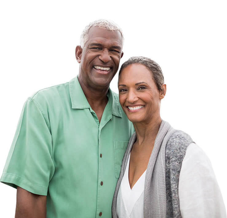 Older couple with whole healthy smiles