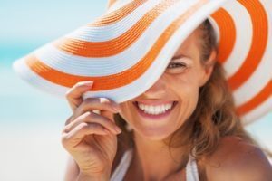 woman smiling in a sun hat
